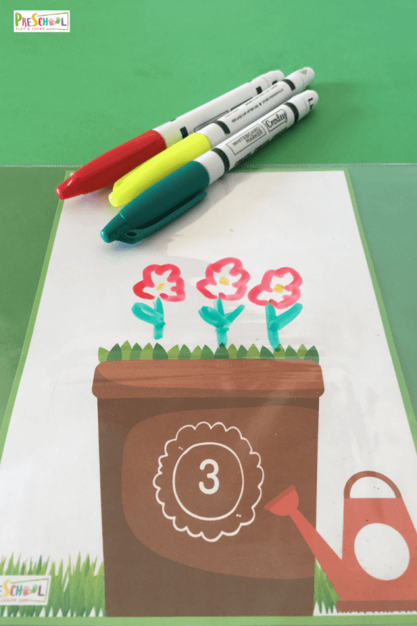 Count to 10 flower by drawing them using dry erase markers