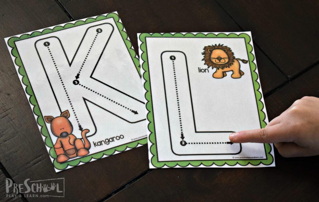 Practicing tracing letters with your finger for letter k is for kangaroo and letter l is for lion.