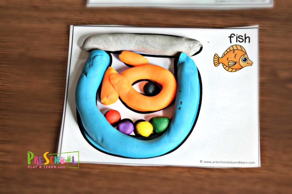 Fish playdough mat - Preschool printables that focus on strengthening hand muscles