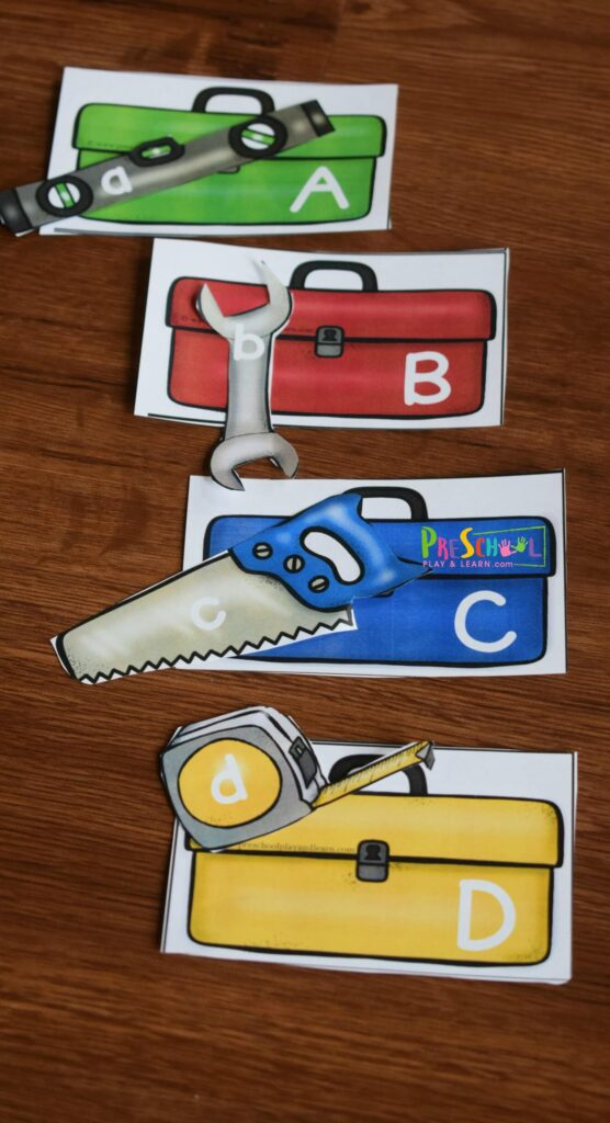 FREE Construction ABC Game is a fun way for kids to practice matching upper and lowercase letters in this tool themed alphabet activity for toddler, preschool, and kindergarten age kids. #preschoolers #alphabet #preschoolthemes