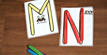 Using popsicle sticks, form uppercase letters using the template provided.