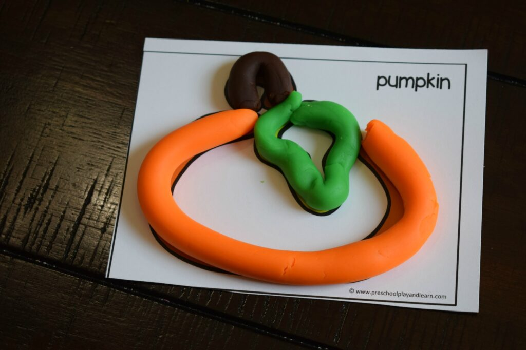 fall themed playdough cards like this pumpkin playdough template for kids to strengthen hand muscles
