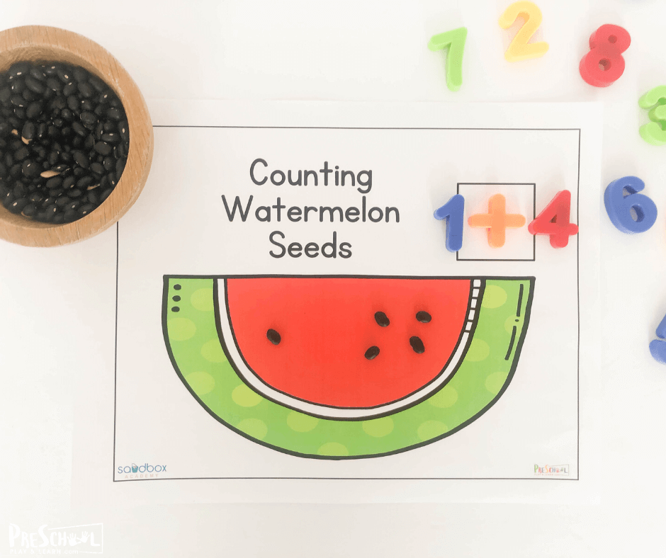 use watermelon seeds and magnetic numbers to practice counting with a watermelon theme