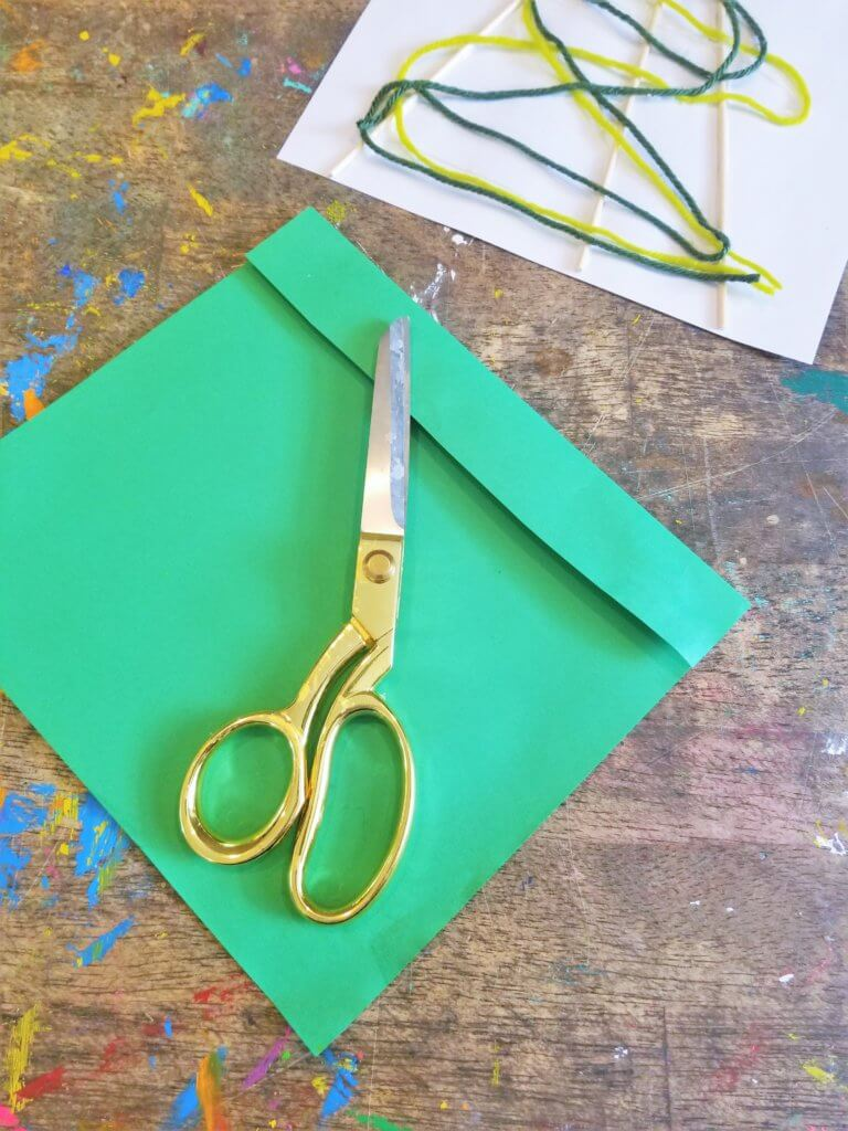 cut green construction paper into pods