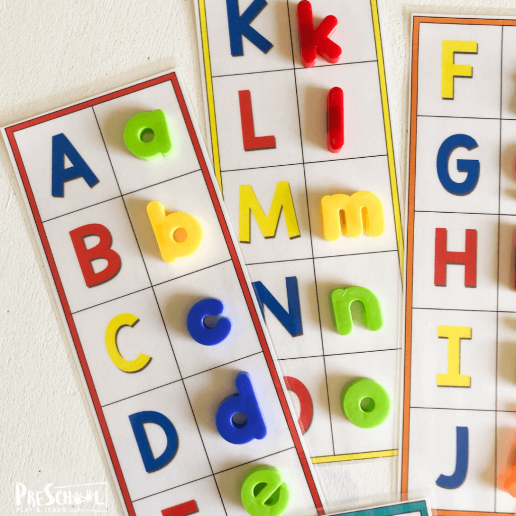 free printable Alphabet Mats to work on literacy as preschoolers match letter magnets with upper and lowercase letters, trace the letters, and match cute clipart that has the same beginning sounds.