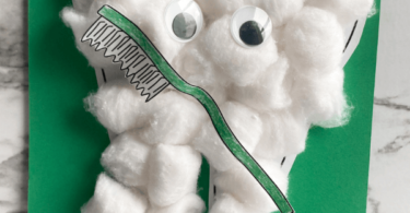 Learn about your teeth for Dental Health Month in February with these super cute and easy-to-make Tooth craft. This dental craft  is made of cotton balls and a few extra dental printables to make this Mr. Toothy Cotton Ball Craft. My kids loved making it and your toddler, preschool, pre-k, kindergarten, and first grader will too!