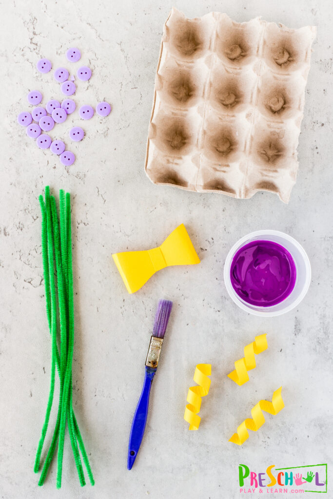 egg carton scissors paint - any color, we used purple cardstock buttons glue gree pipe cleaners