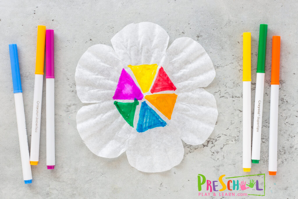 Start out by cutting the coffee filter to look like a large multi-petal flower. Next make a triange in the base of each petal (as shown).