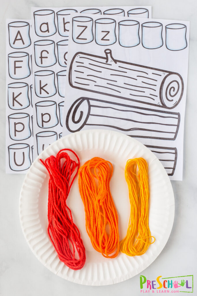 All you need to make this roasing marshmallows craft with kids are a few simple materials: white paper plate hole punch scissors glue crayons, markers, or colored pencils yarn - red, yellow, and orange smores printables with alphabet marshmallows (at bottom of the post)