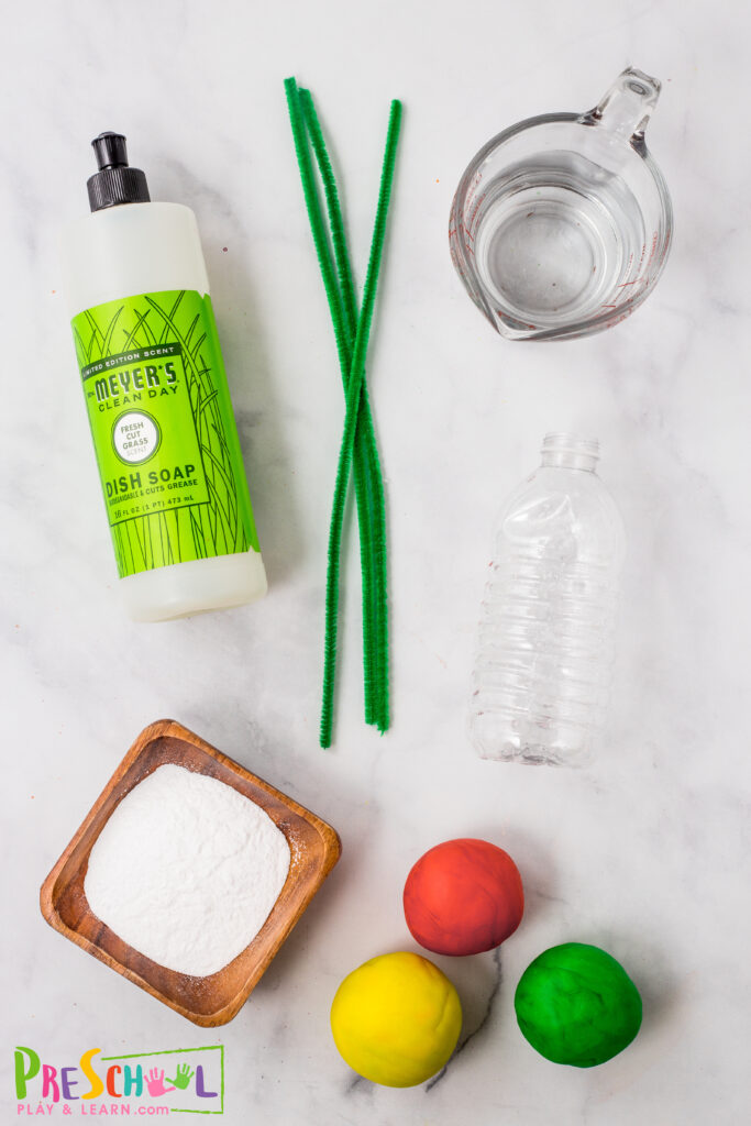 playdough - red, yellow, and green clean empty plastic water bottle green pipe cleaner to make stems / leaves 1/2 cup baking soda 1-2 tablespoons warm water 1 cup of distilled white vinegar 2 tablespoons dish soap food coloring