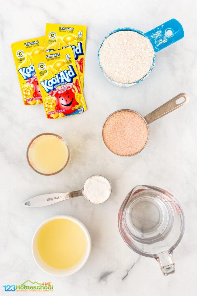 1 cup flour 3 packets of Kool-Aid lemonade (25 cents each at Walmart) 1/2 cup salt 1 tablespoon cream of tartar 2 tablespoons vegetable oil 1/2 cup lemon juice 1/2 cup water