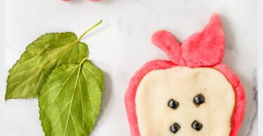 Young kids not only love playing with play dough, but it is great for strengthening hand muscles, sensory activity, and exploring creativity too. Thisapple playdough is a quick and easy-to-makeautumn playdough to enjoy in September. Use thisfall playdough recipe with toddler, preschool, pre-k, kindergarten, first grade, and 2nd graders too. Whether you use thisapple playdoh as part of anapple theme or hands-onapple activities - this is sure to delight the senses!