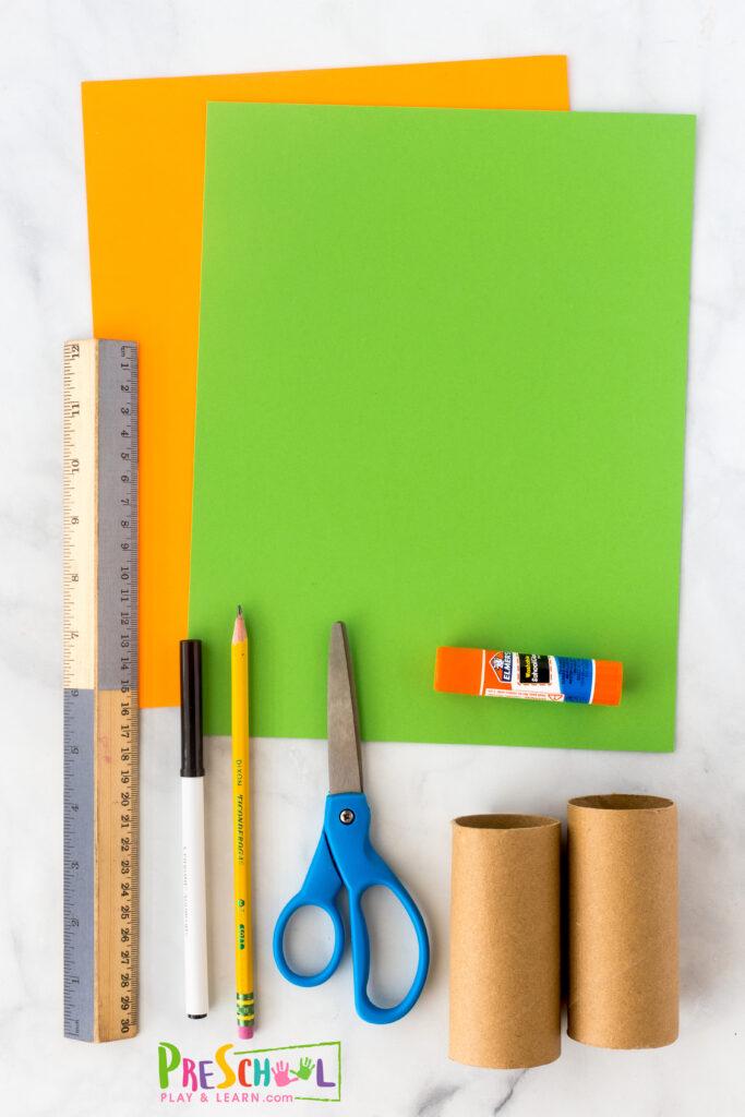 toilet paper roll construction paper - orange and green black marker ruler pencil scissors glue or tape