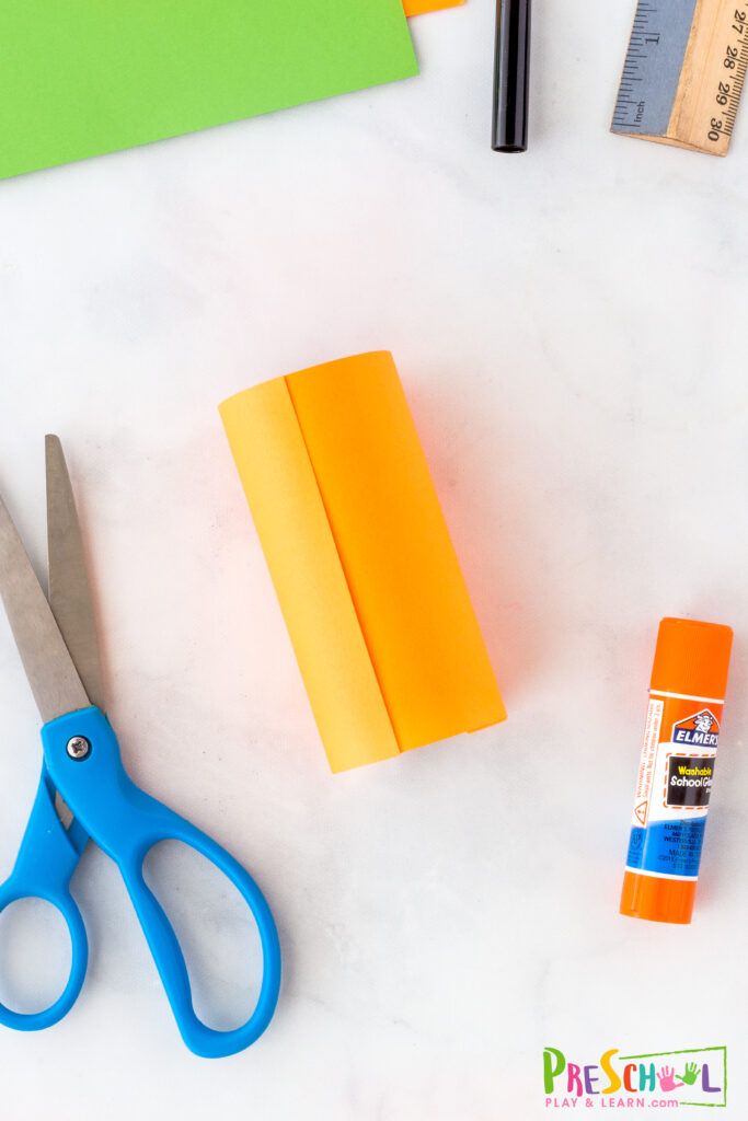 orange construction paper covered tp roll